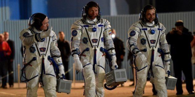 From L: US astronaut Scott Kelly and Russian cosmonauts Gennady Padalka and Mikhail Kornienko walk after...