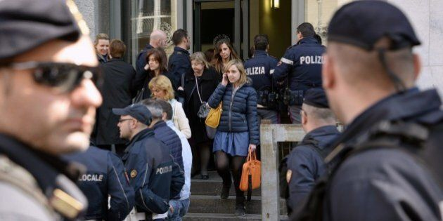 People evacuate Milan's court after a shooting on April 9, 2015. An armed man, identified as Claudio...