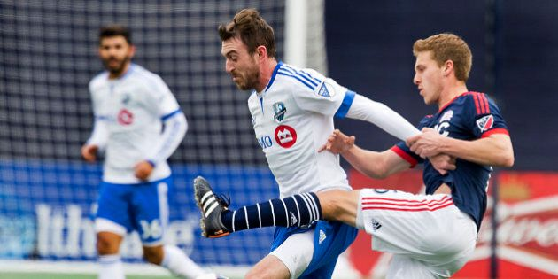 FOXBOUROUGH, MA - MARCH 20: New England Revolution Scott Caldwell (right) pressures Montreal Impact Eric...