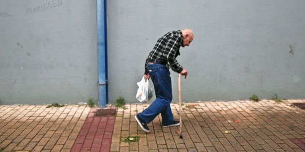 A man holds a bag with food as he leaves a New Year's meal for homeless organized by municipality of...