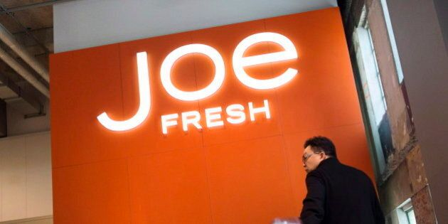 A shopper rides an escalator to the Joe Fresh outlet located in the former Maple Leaf Gardens in Toronto...