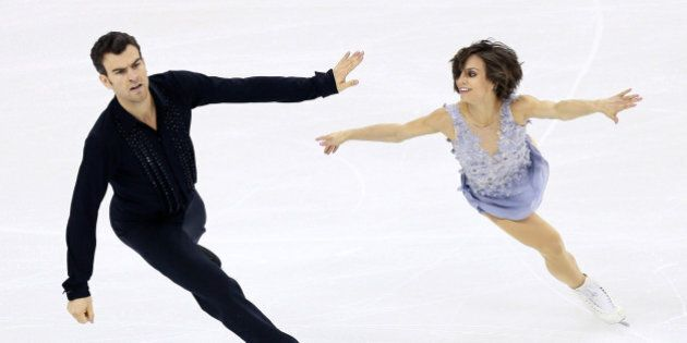SHANGHAI, CHINA - MARCH 25:  Meagan Duhamel and Eric Radford of Canada perform during the Pairs Short Program on day one of the 2015 ISU World Figure Skating Championships at Shanghai Oriental Sports Center on March 25, 2015 in Shanghai, China.  (Photo by Xiaolu Chu/Getty Images)