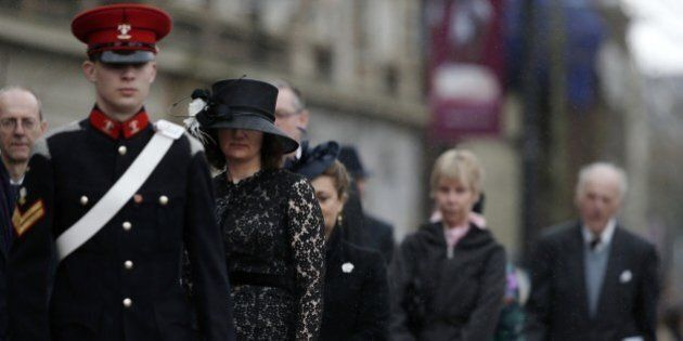 Members of the congregation file into Leicester Cathedral in central England, on March 26, 2015, ahead of a service of reinterment for England's King Richard III. England's slain king Richard III, exhumed from an undignified grave beneath a car park, will finally be buried with honour on Thursday in an unprecedented ceremony filled with pageantry and poignancy.  AFP PHOTO / ADRIAN DENNIS/POOL        (Photo credit should read ADRIAN DENNIS/AFP/Getty Images)