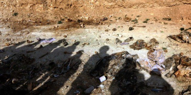 Members of the Yazidi minority search for clues on February 3, 2015, that might lead them to missing...