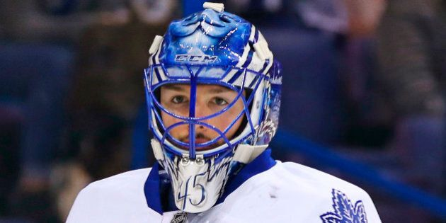 Toronto Maple Leafs goalie Jonathan Bernier is seen during the second period of an NHL hockey game against...
