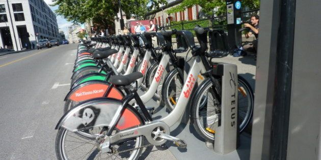 Some bicycles of BIXI - the word is a contraction of Bicycle and Taxi - the sharing system of Montreal, are seen on September 14, 2011 in Montreal Canada. The bicycle is designed and produced in Canada and made of aluminium. The city of New York announced on September 14, 2011 a plan to buy 10,000 of these bicycles for the American partner Alta Bicycle Share. The bicycles and parking-stations for New York will be produced in Canada. AFP PHOTO / Guillaume LAVALLEE (Photo credit should read Guillaume Lavallée/AFP/Getty Images)