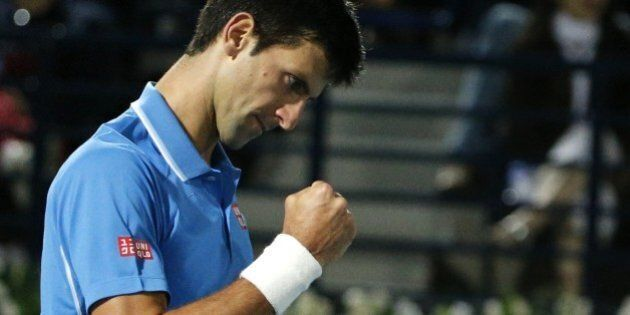 World number one Novak Djokovic of Serbia reacts after winning a point against Tomas Berdych of Czech...