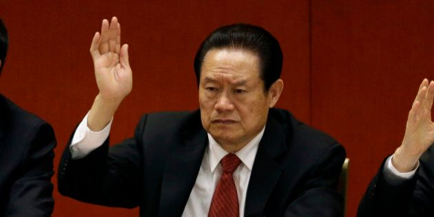 In this photo taken Wednesday Nov. 14, 2012, Zhou Yongkang, then Chinese Communist Party Politburo Standing...