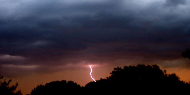 Taken on May 24, 2008.Didn't really catch the lightning on purpose, just lucky timing. The orange glow...