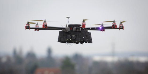 A SteadiDrone EI8GHT Octocopter undergoes a test flight in a field outside the headquarters of Mensuro...