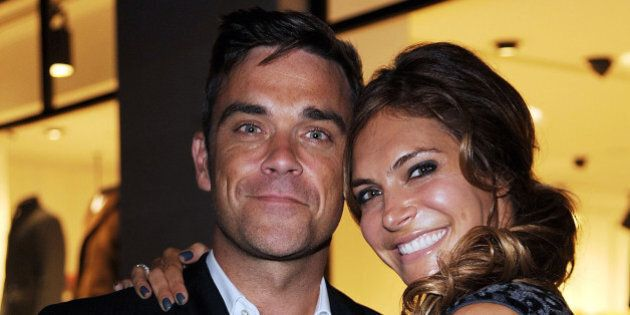 LONDON, ENGLAND - SEPTEMBER 16: Robbie Williams and wife, Ayda Field, attend the launch of the Spencer...
