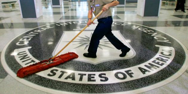 FILE - In this March 3, 2005 file photo, a workman slides a dustmop over the floor at the Central Intelligence...