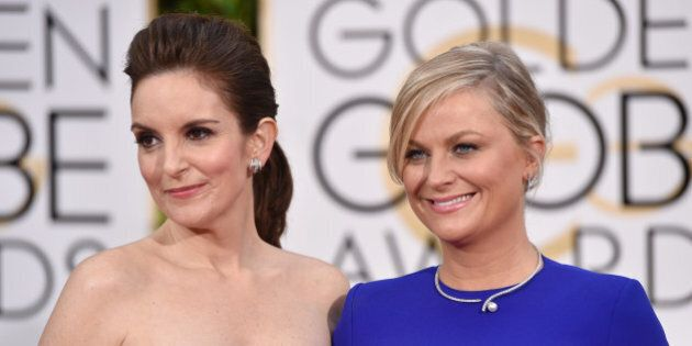 Tina Fey, left, and Amy Poehler arrive at the 72nd annual Golden Globe Awards at the Beverly Hilton Hotel...