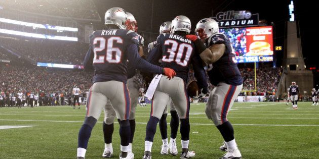 FOXBORO, MA - JANUARY 10:  Duron Harmon #30 of the New England Patriots reacts after intercepting a pass late in the game during the 2015 AFC Divisional Playoffs game against the Baltimore Ravens at Gillette Stadium on January 10, 2015 in Foxboro, Massachusetts.  (Photo by Jim Rogash/Getty Images)