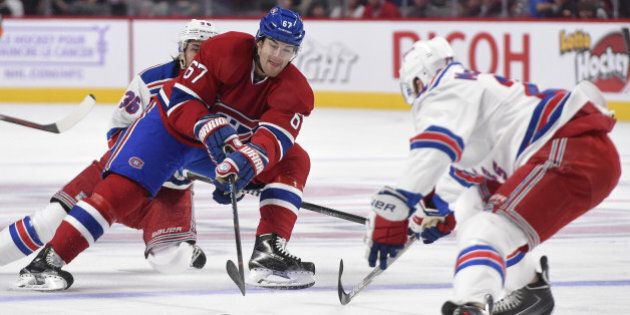 MONTREAL, QC - OCTOBER 25: Max Pacioretty #67 of the Montreal Canadiens controls the puck being challenged...