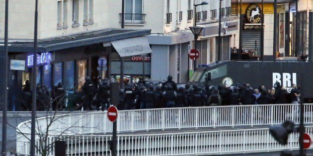 Members of the French special police forces launch the assault at a kosher grocery store in Porte de...
