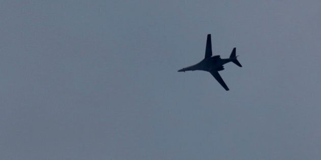 A fighter aircraft of the US-led coalition flies over Mursitpinar in the outskirts of Suruc, at the Turkey-Syria...