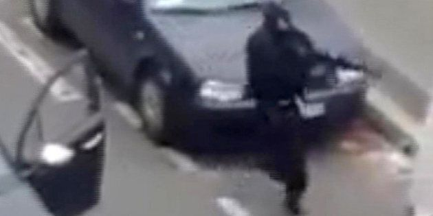 Masked gunman fire their weapons outside the French satirical newspaper Charlie Hebdo's office, in Paris,...
