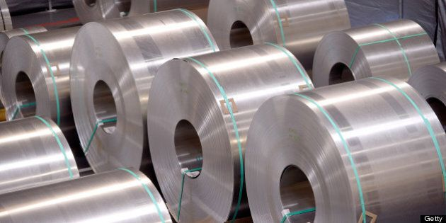 Rolls of aluminum for making Telsa Motor Inc. Model S sedans wait to be stamped at the company's assembly...