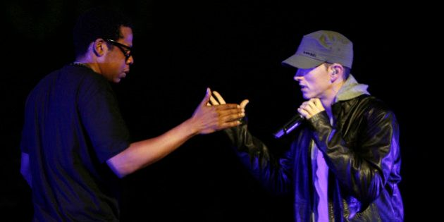 Rappers Eminem, right, and Jay-Z perform together at a concert celebrating the launch of the video