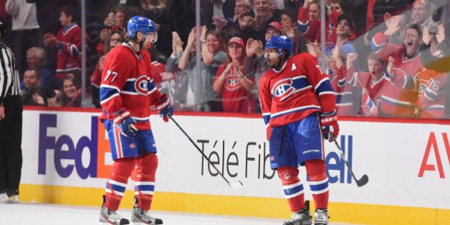 MONTREAL, QC - OCTOBER 18: P.K. Subban #76 of the Montreal Canadiens celebrates with Tom Gilbert #77...