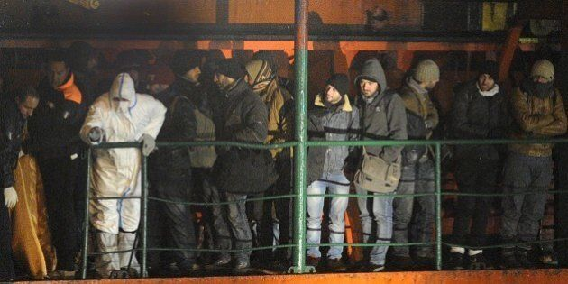 Migrants wait early on December 31, 2014 aboard the Moldovan-flagged ship Blue SKy M. in the port of...