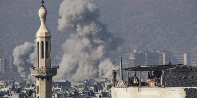 DAMASCUS, SYRIA - DECEMBER 31: Smoke rises after the airstrikes staged by Asad regime air forces to the...