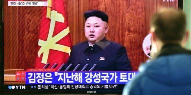 A South Korean man watches a television screen showing North Korean leader Kim Jong-Un's New Year speech,...