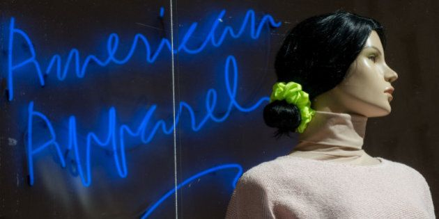 A mannequin stands in the window of an American Apparel Inc. store in New York, U.S., on Friday, Feb....