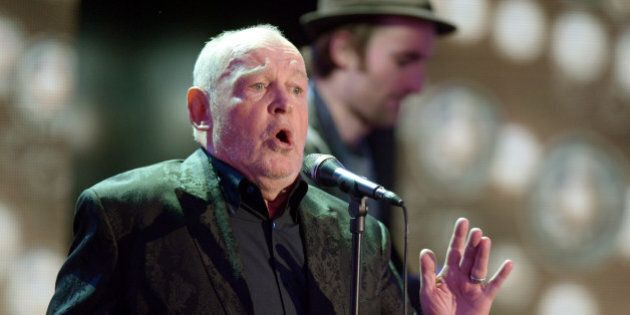 British singer Joe Cocker performs after receiving the trophy for Category 'lifetime achievement award...