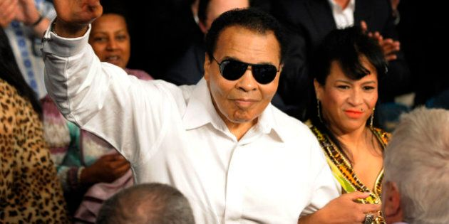 FILE - This May 1, 2010 file photo shows boxing legend Muhammad Ali waving seen before the Floyd Mayweather...