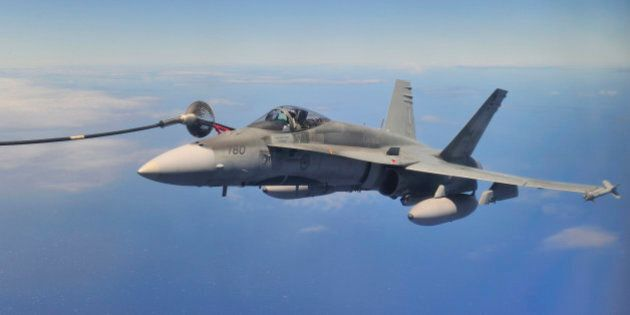 PACIFIC OCEAN (July 25, 2012) A Royal Canadian Air Force (RCAF) CF-18 Hornet from 425 Tactical Fighter Squadron in Bagotville, Quebec, gets refueled by a RCAF CC-130 Hercules air-to-air refueller from 435 Transport and Rescue Squadron, Winnipeg, Manitoba, over the Pacific Ocean near Joint Base Pearl Harbor-Hickam, in Honolulu, Hawaii, July 25 2012.  Twenty-two nations, more than 40 ships and submarines, more than 200 aircraft and 25,000 personnel are participating in the biennial Rim of the Pacific (RIMPAC) exercise from June 29 to Aug. 3, in and around the Hawaiian Islands.  The world's largest international maritime exercise, RIMPAC provides a unique training opportunity that helps participants foster and sustain the cooperative relationships that are critical to ensuring the safety of sea lanes and security on the world's oceans.  RIMPAC 2012 is the 23rd exercise in the series that began in 1971.  Canadian Forces photo by : MCpl Marc-Andre Gaudreault, Canadian Forces Combat Camera/RELEASED