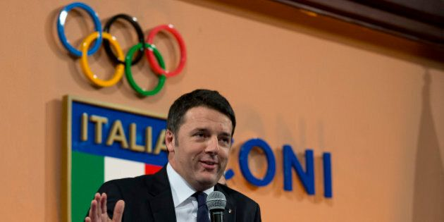 Italian Premier Matteo Renzi delivers his speech at Italian Olympic Committee headquarters in Rome, Monday,...