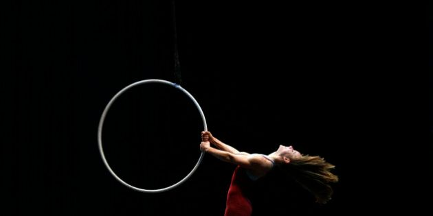 An artist of the Cirque du Soleil performs on the stage during a rehearsal for the media ahead of the