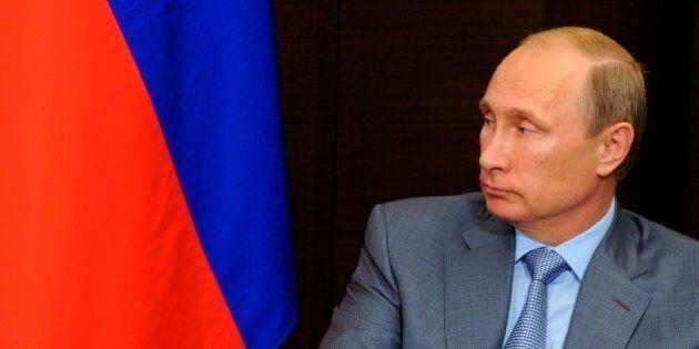 Russian President Vladimir Putin listens to Finnish President Sauli Niinisto prior to their talks at...