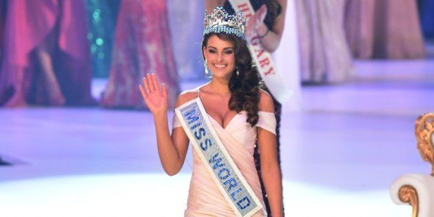 Miss South Africa and the 2014 Miss World, Rolene Strauss, waves after being crowned during the grand...