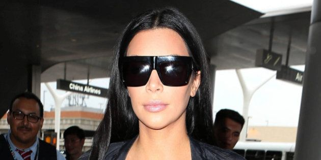 Photo by: KGC-173/STAR MAX/IPx 2015 7/19/15 Kim Kardashian is seen at Los Angeles International Airport...