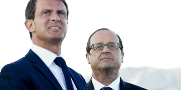 French President Francois Hollande (R) and French Prime minister Manuel Valls, look at planes of the...