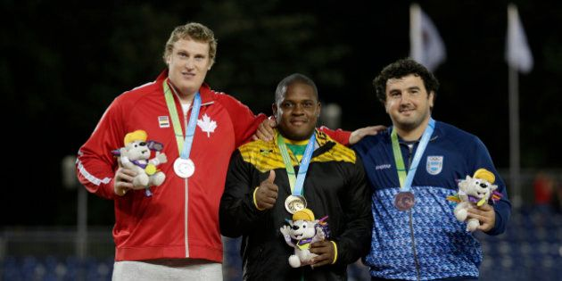 Left to right: silver medalist Timothy Nedow of Canada, gold medalist O'Dayne Richards of Jamaica and...