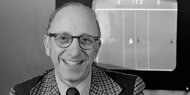 Ralph Baer an engineer for Sanders Associates, Inc., of Nashua, New Hampshire, watches his TV hockey...
