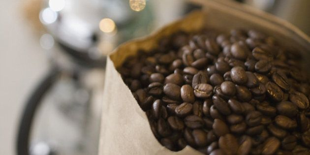 Bag of coffee beans with coffee