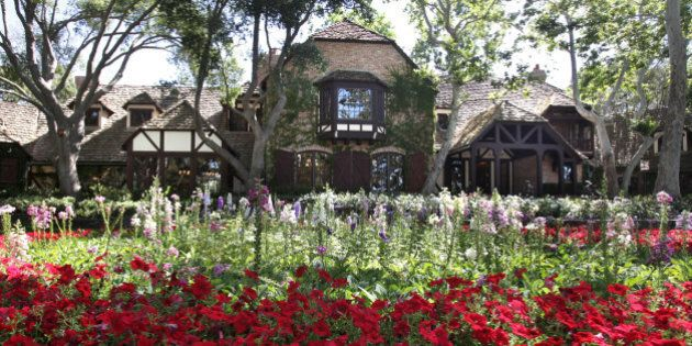 FILE - In this July 2, 2009 file photo, the front of the main house at Neverland Ranch is seen in Los...
