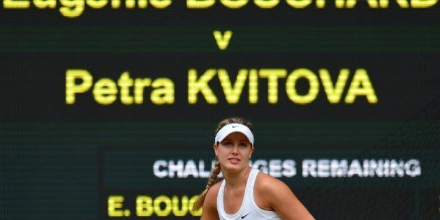Canada's Eugenie Bouchard eyes the ball from Czech Republic's Petra Kvitova during their women's singles...