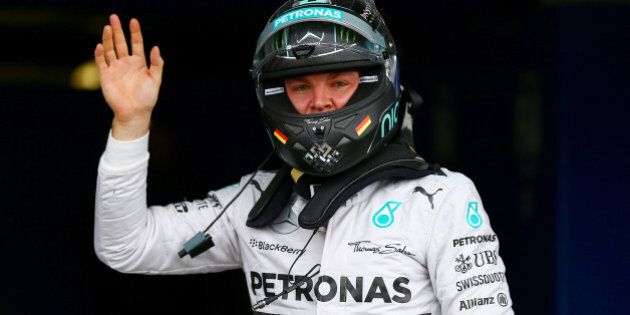 NORTHAMPTON, ENGLAND - JULY 05: Nico Rosberg of Germany and Mercedes GP celebrates in Parc Ferme after...