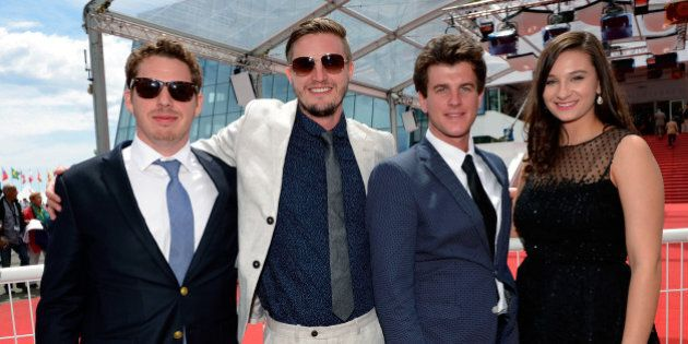 CANNES, FRANCE - MAY 21: (L-R) Director of photography Zach Graber, producer Tyler Reid, director Ryan Curtis and subject of 'Ovation For Oscar' Sloane Mayberry pose in front of the red carpet after the 'SCAD Presents Cannes Documentary Screening for Ovation For Oscar' at Palais des Festivals on May 21, 2015 in Cannes, France. (Photo by Luca Teuchmann/Getty Images for SCAD)