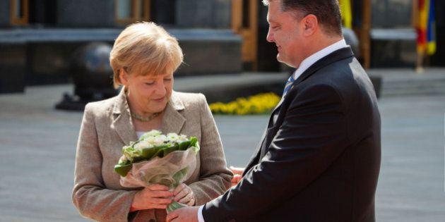 KIEV, UKRAINE - AUGUST 23: President of Ukraine Petro Poroshenko (R) welcomes German chancellor Angela...