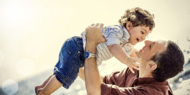Father holding two years old son in the