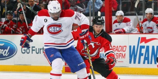 NEWARK, NJ - JANUARY 02: P.K. Subban #76 of the Montreal Canadiens controls the puck while being pursued...