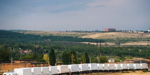 Lorries part of a Russian humanitarian convoy are parked not far from a checkpoint at the Ukrainian border...