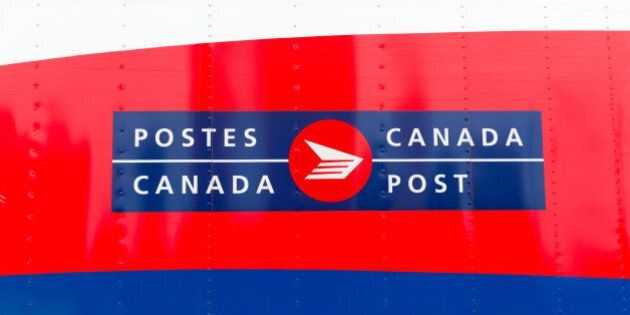 TORONTO, CANADA - 2014/06/20: Canada Post Corporation, known more simply as Canada Post is the crown...